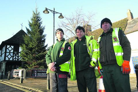 From left, Royal Wootton Bassett council groundsmen John Macindoe, Mike Stacey and John Smart with a 35ft Christmas tree which has just been put up in the High Street