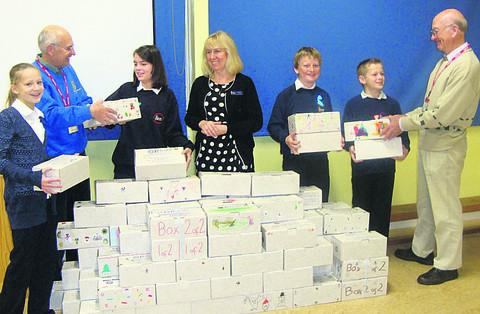Georgette Jeapes, Rotarian John Loran, Anne Woodhouse, Suzanne Lane, Dominic Thomas, Kieran Byrne and Rotarian Bernard Aslett with shoe boxes filled with gifts