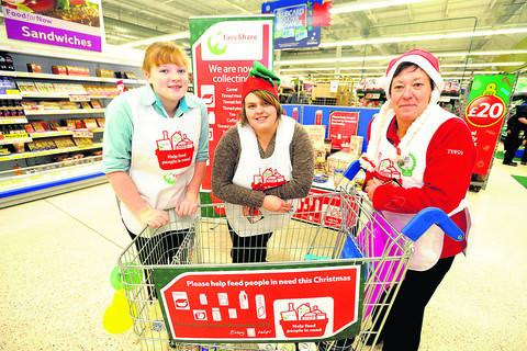 Helpers, from left, Guide Sophie Carrol and Tesco staff Emma Clifford and Mel Kervin