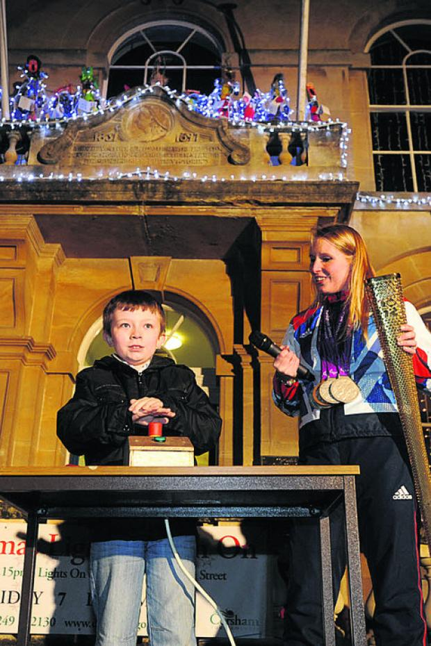 Stephanie Millward with Owen Cox at the switch-on