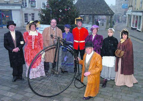 Preparing for the festive Victorian day are mayor Andy Phillips, mayoress Nina Phillips, Coun Peter Hutton, PR manager Emma King, David Dorey, Mellissa Barnett, Elle Bowden and Vicky Walsh. Front Brian Mortimer, with a penny farthing