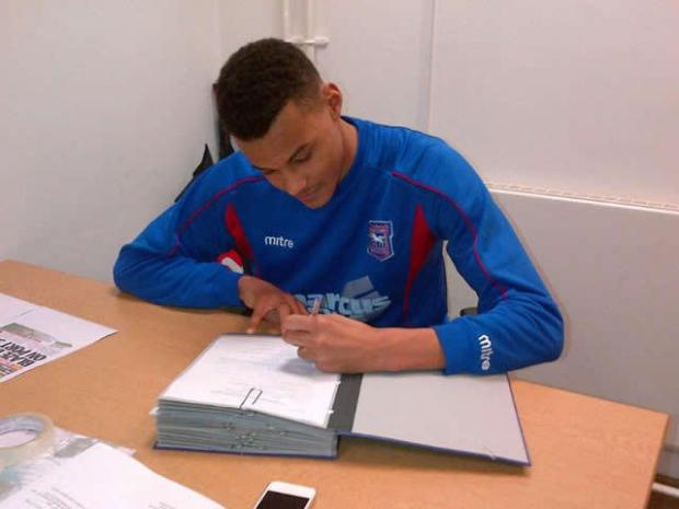 Tyrone Mings signs his contract with Ipswich Town this afternoon (Picture: Ipswich Town FC)