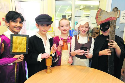 Keira, Joseph, Hollie, Macey and Leon with items used as part of their Tudor project