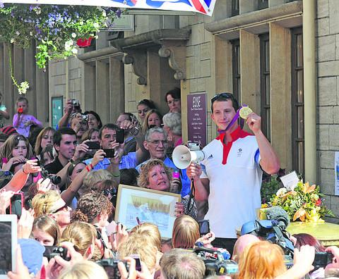 Ed McKeever with his Olympic gold medal in Bradford on Avon
