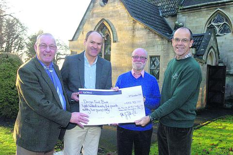 Food bank organisers Alan Beamish, Michael Ash, Jasper Selwyn, and food bank chairman Peter Brearley with a cheque for £875.92p from the parish autumn bazaar