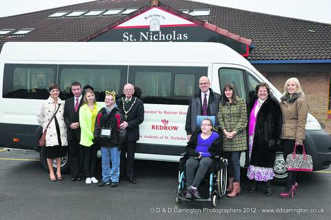 The new minibus is handed over to staff and pupils of St Nicholas School