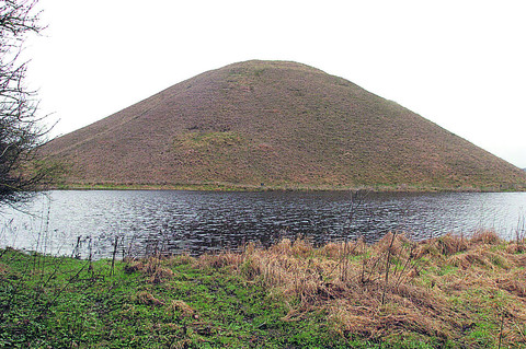 So much rain has fallen that Silbury Hill now looks like it is surrounded by a moat