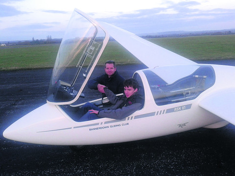 Luke Knight is congratulated on his first solo flight by Ian Harris, Bannerdown's chief flying instructor