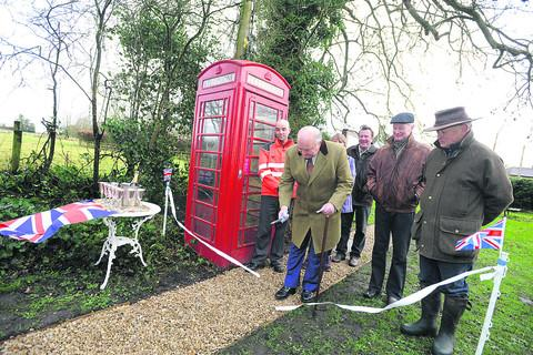 Coun Robert Hall cuts the ribbon to declare the footpath open