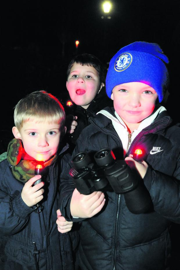 Troy Dredge, Archie Machin and Owen Bridewell with their torches and binoculars
