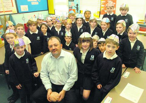 Experimental psychologist Dr David Turk with pupils from St Joseph's Catholic Primary School