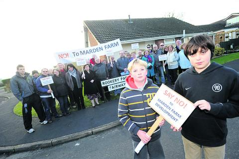 Louis Warnett and Aran Greig, at the front, take part in a demonstration about the proposed new housing development at Marden Farm, Calne