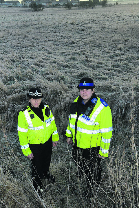PC Emma Reed and PCSO Lucy Sainsbury at the site where the RAF Sea King landed