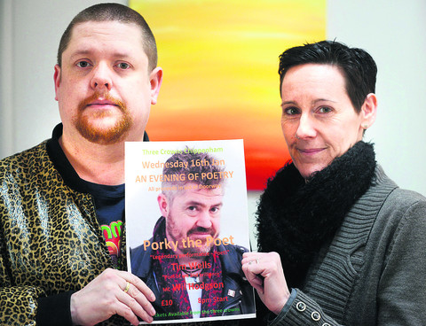Comic Will Hodgson and charity boss Lisa Lewis with a flyer featuring Phill Jupitus