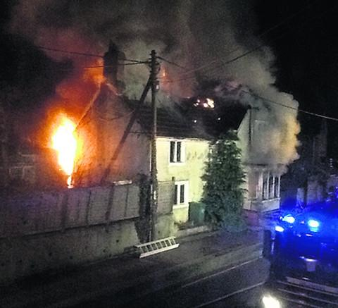 Raymond Cusack, co landlord of the Pack Horse pub, took this picture of the fire ripping through the London Road house