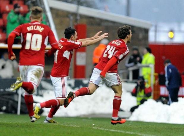 Chris Martin celebrates his first goal for Town