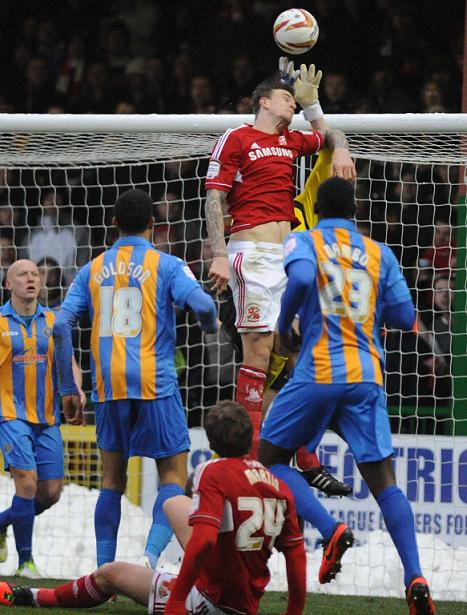 Aden Flint challenges Shrewsbury keeper Chris Weale