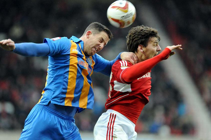 Chris Martin, right, in action against Shrewsbury