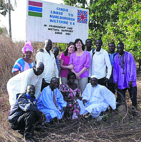 Devizes MP Claire Perry and daughter Eliza in the village of Gunjur in The Gambia, which has been linked to Marlborough for 30 years