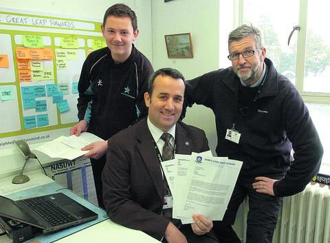 Head teacher Trystan Williams with Matt Crosby and Jon Hampwith