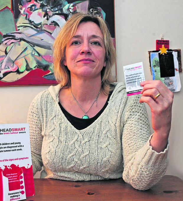 The Wiltshire Gazette and Herald: Danica Marshall with the HeadSmart symptom cards distributed to all schools across Wiltshire