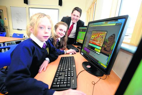 Chippenham MP Duncan Hames with pupils Stacey Pegler and Portia Grant in Sheldon School's new learning support facility