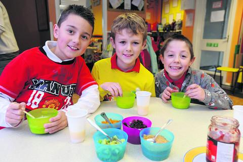 The Wiltshire Gazette and Herald: Keelan, Sean and Sam tuck into their healthy breakfast