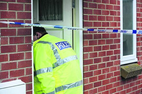 A police officer investigates the scene of the  incident in Chippenham  (TK108