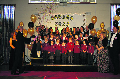 Pupils and staff of Corsham Primary School take to the stage for their Oscars-style awards ceremony to honour their achievements