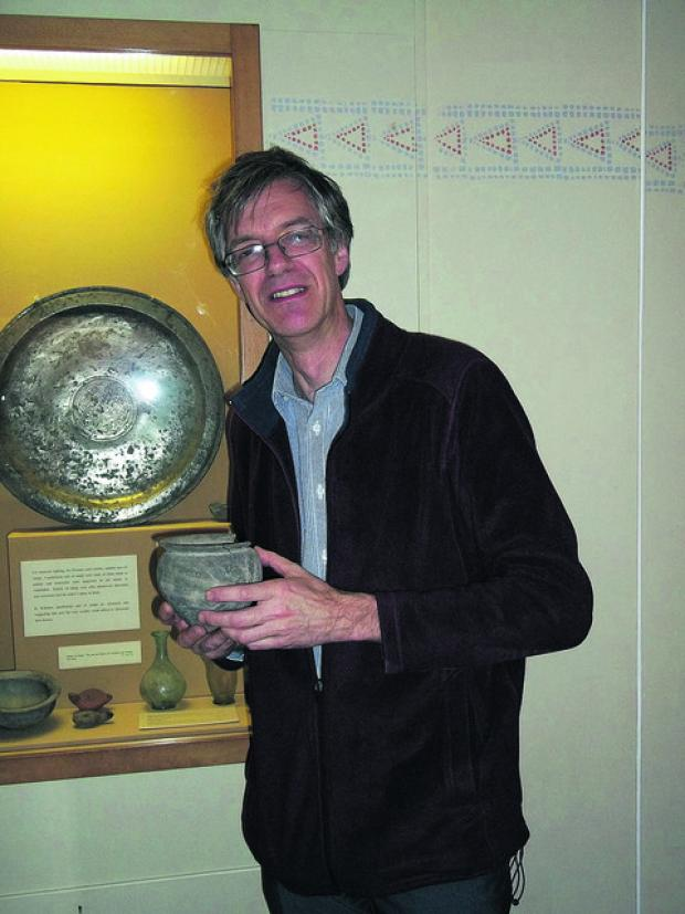 The Wiltshire Gazette and Herald: David Dawson with a Roman piece from the 3rd century AD found in a grave in Devizes in the 1920s