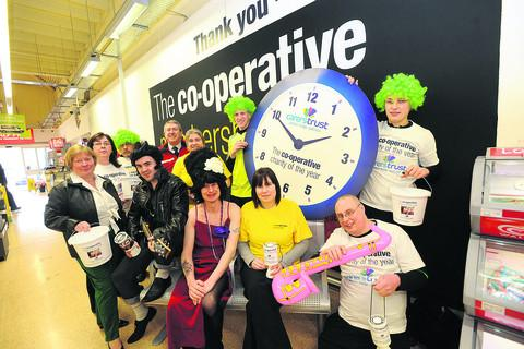 Staff from the Malmesbury Co-op who dressed up to rock around the clock for charity