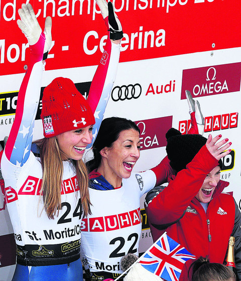 Shelley Rudman (middle) celebrates her World Championship triumph with silver medallist America's Noelle Pikus-Pace (left) and bronze winner, Sarah Reid, of Canada (Pictures: AP Photo/Keystone, Arno Balzarini)