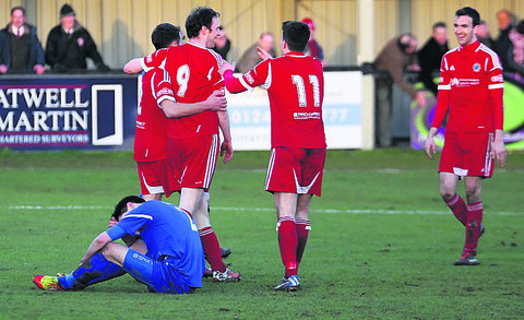 Chippenham Town's Toby Osman is grounded after Kevin Squire's strike for the final goal during Saturday's 7-1 home defeat by Bideford (Picture by Robin Foster)