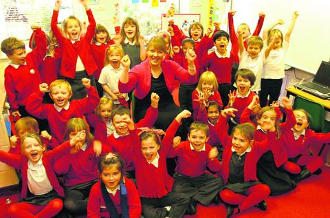 Headteacher Charlotte Robinson and Year 1 pupils celebrate Wansdyke Primary School's academy status