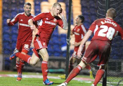The Wiltshire Gazette and Herald: Swindon Town striker James Collins scores the winner against Colchester