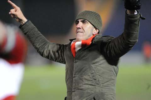 Swindon Town boss Paolo Di Canio at the final whistle last night at Colchester