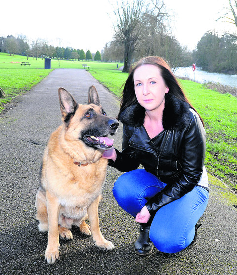 Ainsley Gillespie with her German Shepherd Jaeger, who chased away an attacker