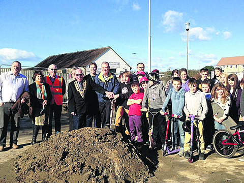 Malmesbury mayor Ray Sanderson, Coun John Thomson, residents and skaters celebrate the start of building work