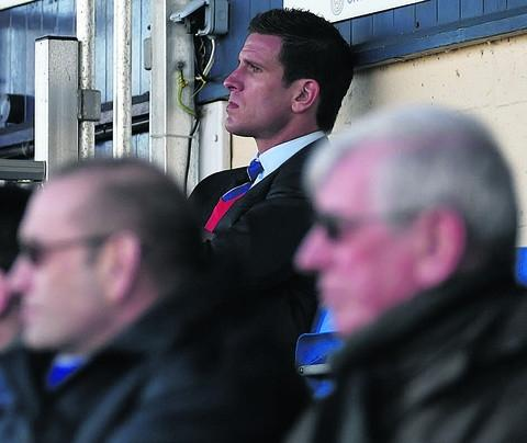 Chippenham Town manager Nathan Rudge watches on from the stands during last weekend's drubbing by Bideford