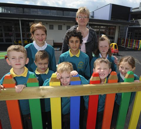 Trinity School head Catherine Davis with youngsters
