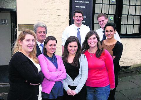 The Wiltshire Gazette and Herald: Mark Barrett, second left, of Riverview Portfolio with Suki Smith, Hayley Fletcher, Michelle Quinney, Lauren England, Shannon Morse, James Moore and Dan Farthing, who all joined the firm as apprentices