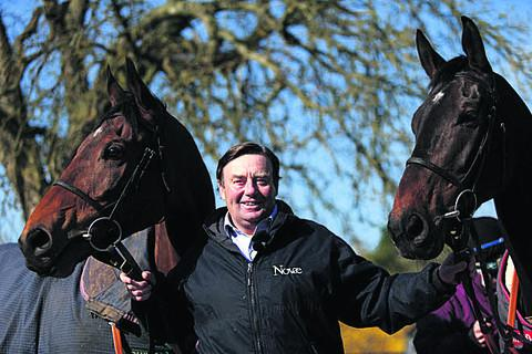 Trainer Nicky Henderson with Bobs Worth (left) and Long Run (right) at Seven Barrows in Lambourn today