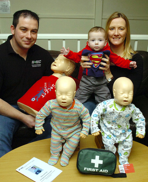 Matt and Anna Johnstone at Scoffs Cafe in Chippenham with six-month-old son Ben and some of the first aid training equipment they've been using.                     .