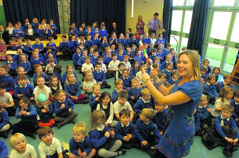 The Wiltshire Gazette and Herald: Debbie Liddle, deputy headteacher of Sherston School, sings along with the pupils during the event