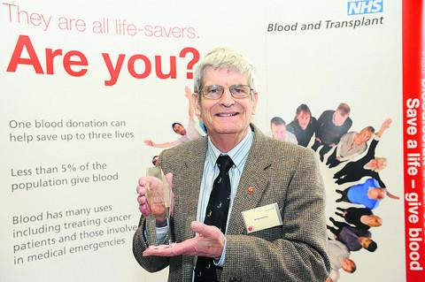 Bernard Fox, who gave his first blood donation in 1962, receives his trophy