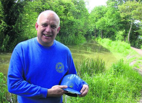 Volunteer Derek Flexer in front of the restored Wilts & Berks Canal near Pewsham