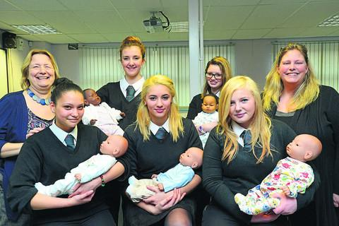 Royal Wootton Bassett Academy pupils Caylyn, Sasha, Joné, Milly and Lilly with their virtual babies. Included, left, community officer Linda Woodruffe, and right, student manager Kerry Heaphy			         picture by thomas kelsey
