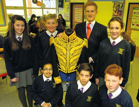 Matt Crocker, from Gieves & Hawkes, and Sheldon School pupils (back row, from left) Amelia Walters, Tom Tennant and Chloe Jefferies, and (front) Renee Keill, Nick Pasi and Harry Kershaw with Michael Jackson's £76,000 jacket