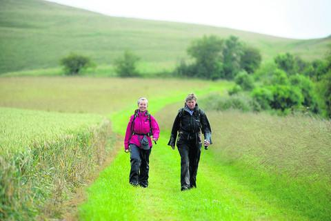 Diane Gilpin, from Great Cheverell, and Hilary Stone, from Littleton Panell, take part in last year's White Horse Challenge