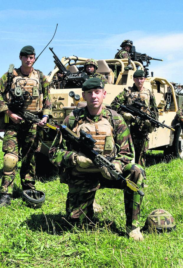 Members of the 1st battalion The Rifles on an exercise on Salisbury Plain. The MoD reshuffle will mean an increase in activity on the Plain and in the surrounding area